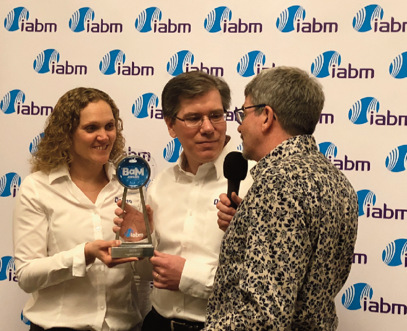 Todd Scneider and Yvonne Monteresso recieving their Award from IABM's Stan Moote